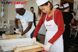 team building & incentive in uae: team cooking pasta making